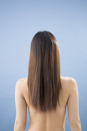 behind: From behind the long hair woman Stock Photo
