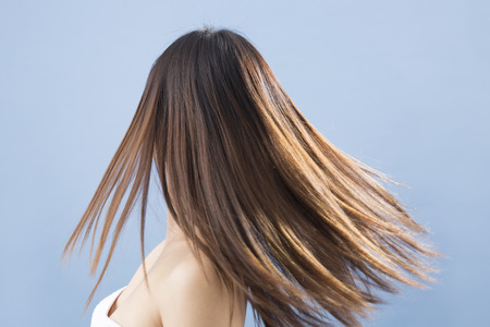 shot from behind: From behind the long hair woman Stock Photo