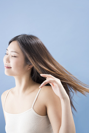 waver: Women in the wind high above Stock Photo