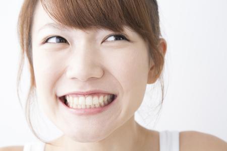 adult brushing teeth: Smiling woman Stock Photo