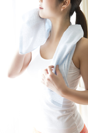 Woman in a towel to wipe the sweat Stock Photo