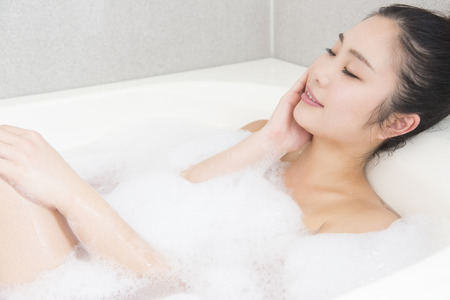 Women take a bath