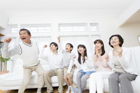 three generation family rejoice 스톡 콘텐츠
