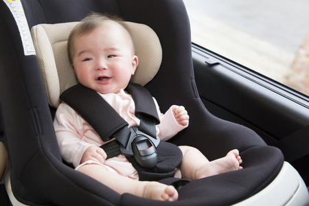 vehicle seat: Baby sitting in a baby seat