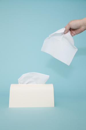 tissue paper: Hand of man to take a tissue paper
