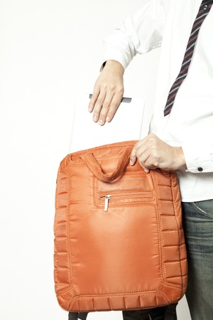 put away: Men put the tablet PC to bag