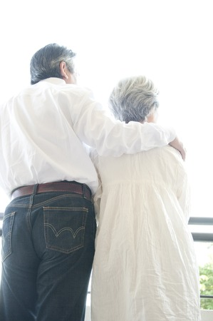 snuggle: Rear View of senior couples snuggle Stock Photo