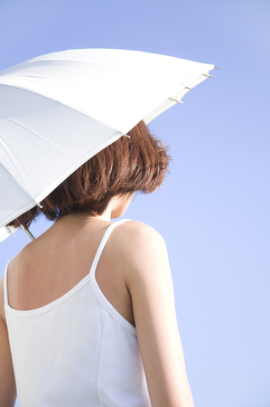 preventing: Back view of women who parasols Stock Photo