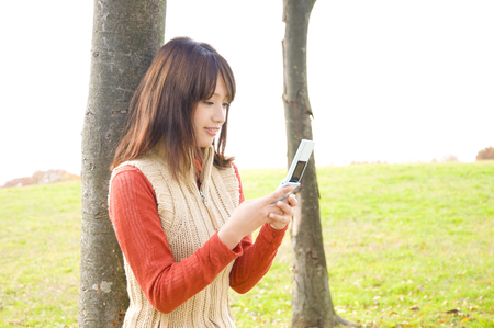 operates: Women who operates the mobile phone