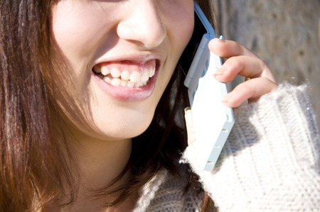 Chatter: Woman talking on cell phone Stock Photo