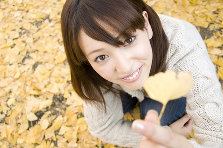 lean over: Women with fallen leaves and squatting