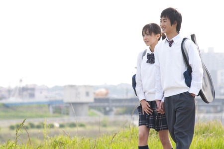 High school a couple walking a riverbed Stock Photo