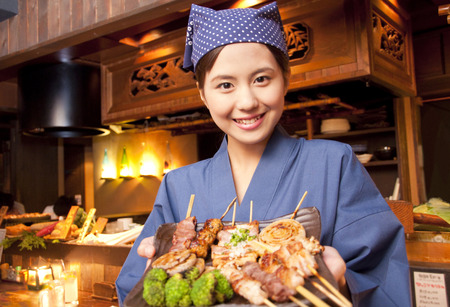 Tavern employees who carry the cuisine Stock Photo