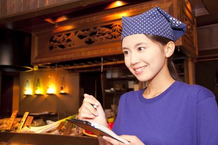 orders: Tavern clerks take orders Stock Photo