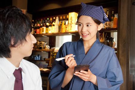 Tavern clerks take orders Stock Photo