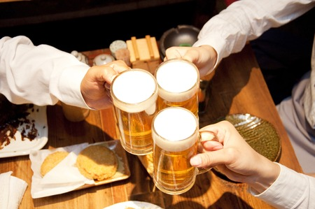 40 year old woman: Businessmen toasting with beer