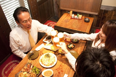 Businessmen toasting with beer