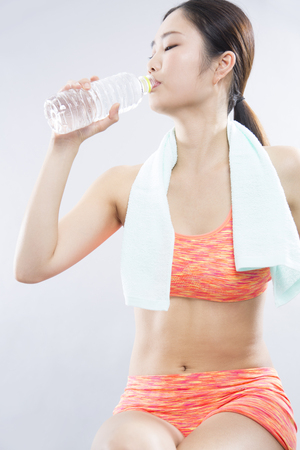 rehydration: Women to rest drink water Stock Photo