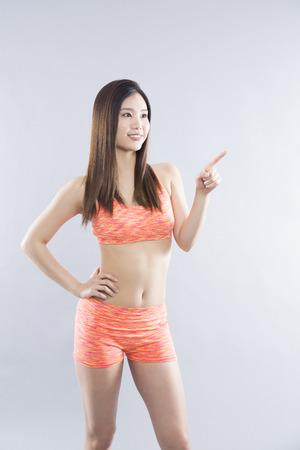 Woman pointing to Standard-Bild
