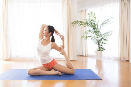 Yoga woman in living room Stock Photo