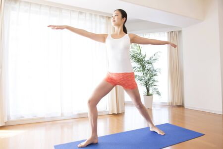 meditation room: Yoga woman in living room Stock Photo