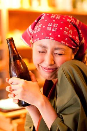 bottled beer: Clerk smile with a bottled beer