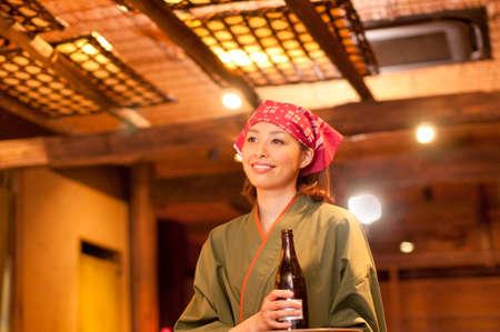 bottled beer: Clerk carrying a bottled beer