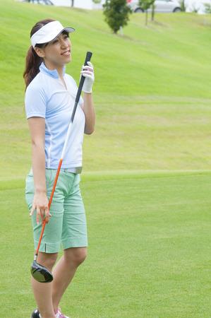 woman golf: Woman holding Golf Club
