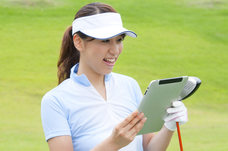 Women smiled at the Tablet PC photo