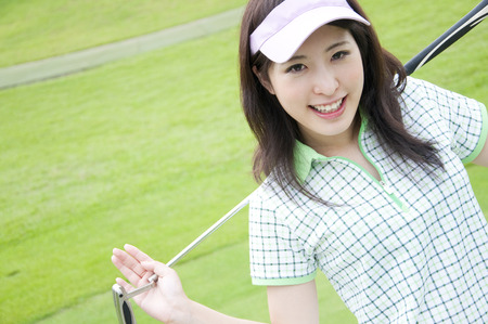 Women have a putter and smiling photo