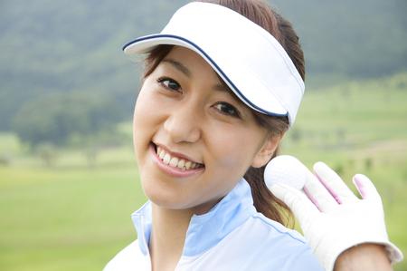 woman golf: Woman holding golf balls Stock Photo