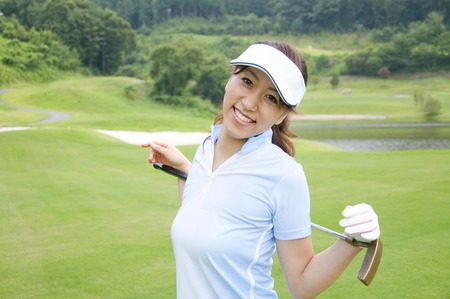 putter: Women have a putter and smiling