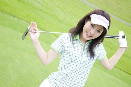 Women have a putter and smiling
