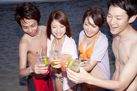 Men and women to toast on the beach