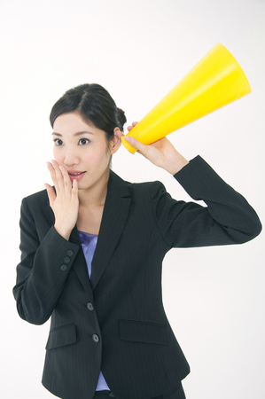 addressed: OL smile and addressed the megaphone to ear Stock Photo