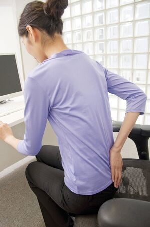 low back pain: OL suffering from low back pain Stock Photo