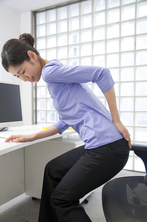neuralgia: OL suffering from low back pain Stock Photo