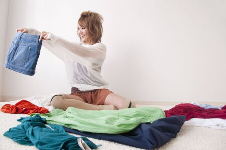 choosing clothes: Woman choosing clothes