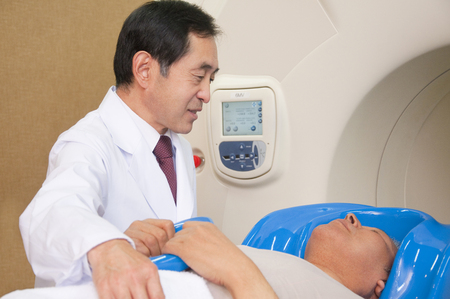 radiation therapy: Male doctor to treatment using radiation therapy equipment