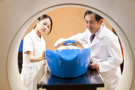 therapy equipment: Treatment with radiation therapy equipment to male doctor and nurse Stock Photo