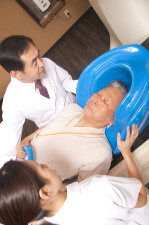 radiation therapy: Treatment with radiation therapy equipment to male doctor and nurse Stock Photo