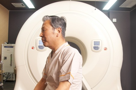radiation therapy: Radiation therapy device and the male patient Stock Photo