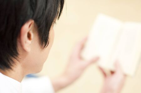latency: Rear View of male doctor reading a book Stock Photo