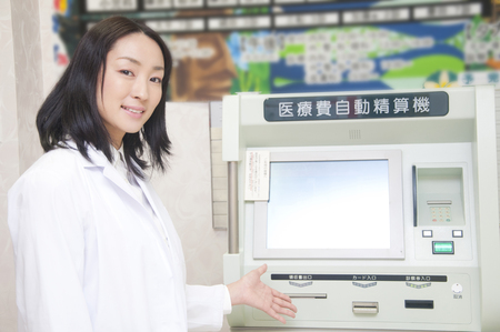 medical expenses: Woman doctor pointing to the medical expenses automatic adjustment machine Stock Photo