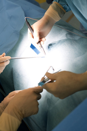 centralised: Hand surgeon surgery Stock Photo