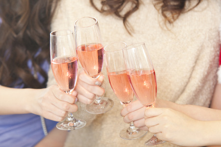 rollick: Hand of four women to toast with champagne