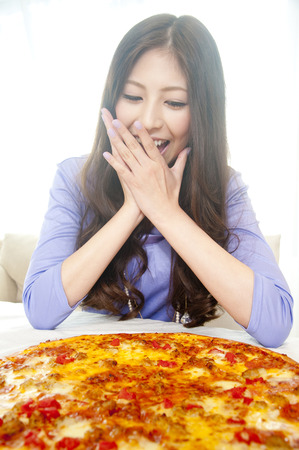 rejoice: Women who rejoice to see the pizza Stock Photo