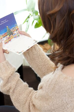 Women read the Christmas card