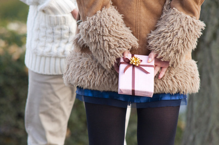 love confession: Rear of women hide gifts Stock Photo