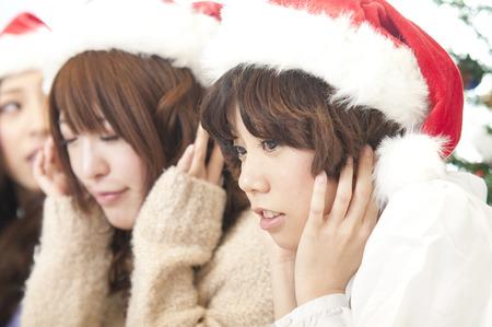 rollick: 2 women block the ear